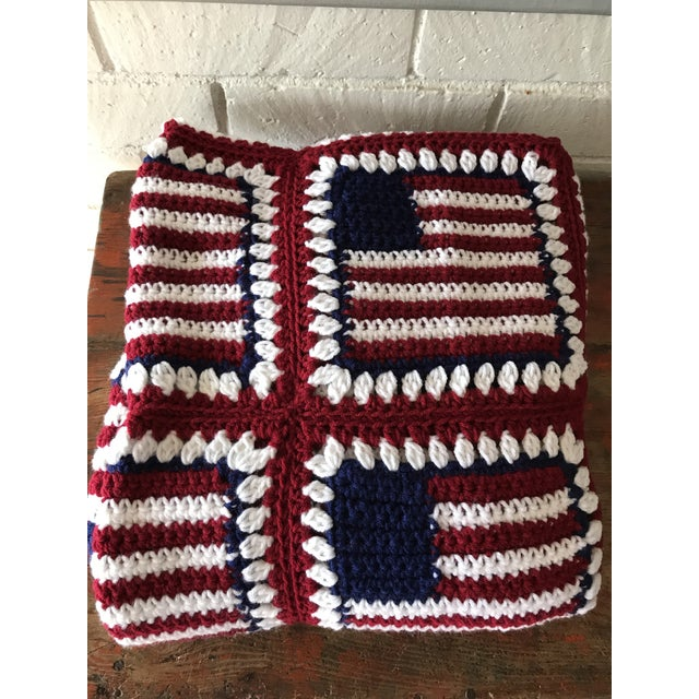 Vintage handmade patriotic knit throw blanket in red, white and blue. Each square in an American flag. In excellent...