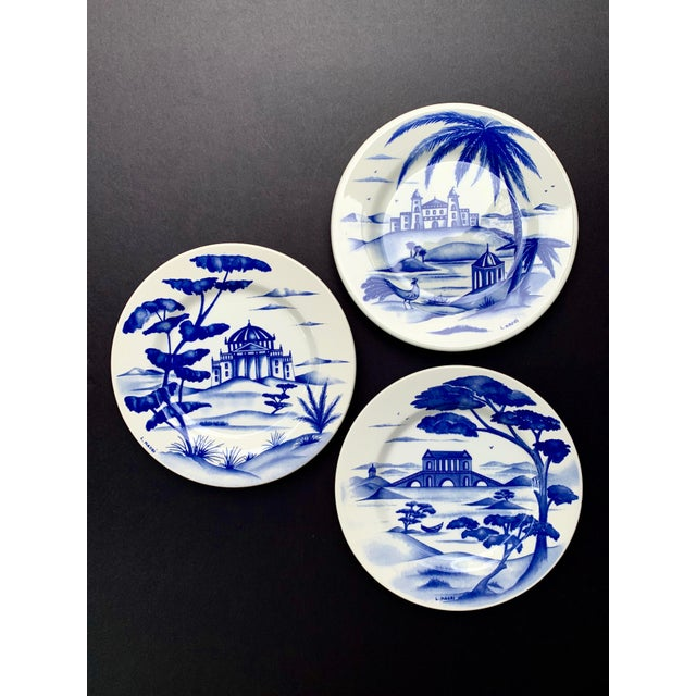 """Warm white 8"""" ceramic plates handcrafted in Italy with a different exotic palace scene painted In royal blue on each one...."""