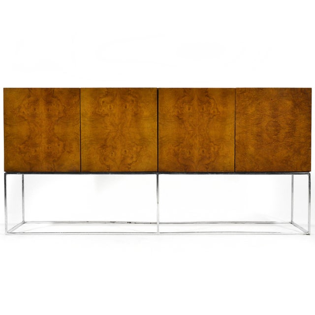 Perched on the chrome architectural base, this Milo Baughman credenza by Thayer Coggin has a great minimalist design...