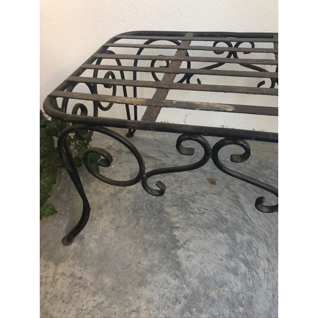 Vintage French motif wrought iron coffee table. Add a cushion to use this as a bench. Heavy gauge with classic scrolls....