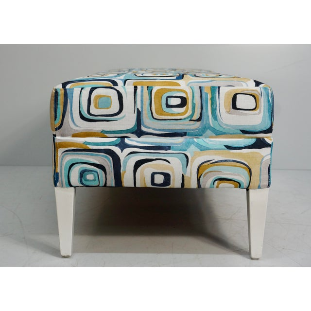 Vintage 1980's bench reupholstered in an artfully abstract blue & tan cubic print with hand-painted white feet. The cotton...