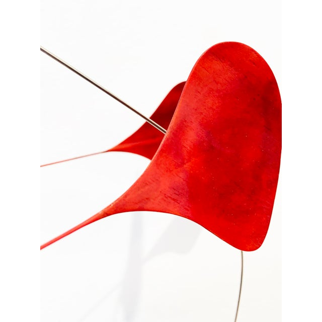 Stabile. Tabletop kinetic sculpture. Wood veneer in bright red and an organic sharp white clay base and stainless steel...