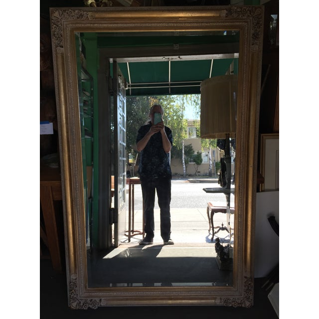 Beautiful large gold mirror with an ornate frame, 20th century, with hooks to hang either direction. Excellent condition...