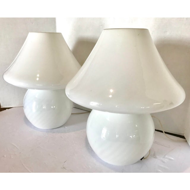 Pair of handblown glass mushroom table lamps in excellent condition. They are made of high quality white Murano glass with...