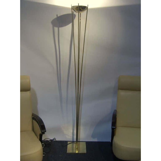 A beautiful and elegant brass torchiere by Relux of Milano Italy. The lamp tales a halogen strip bulb and is working...