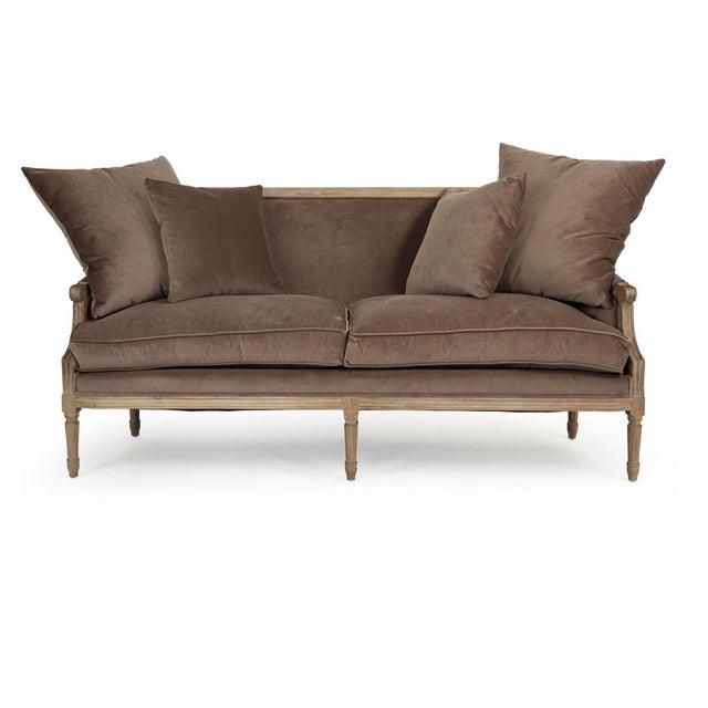 Louis sofa upholstered in brown velvet on limed grey oak frame.