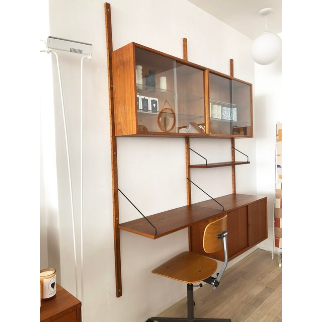 Mid century teak modular 2-bay wall unit designed by Paul Cadovius made in Denmark The teak has been refinished. The 2-bay...