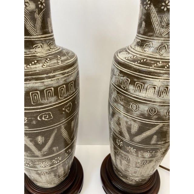 Vintage ceramic and wood table lamps featuring abstract design in taupe and white glaze.