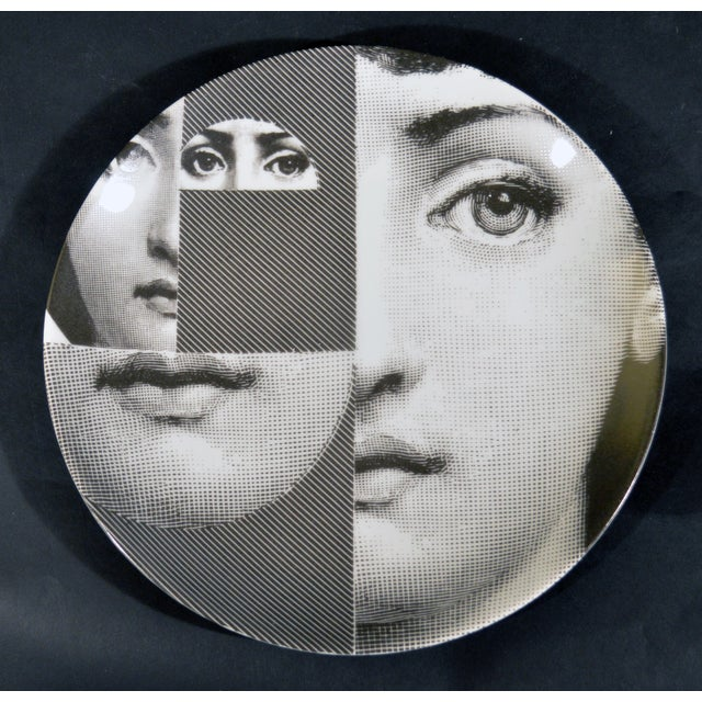 This plate is one of Piero Fornasetti's iconic representations of Lina Cavalieri', #230 in the series. As the Fornasetti...