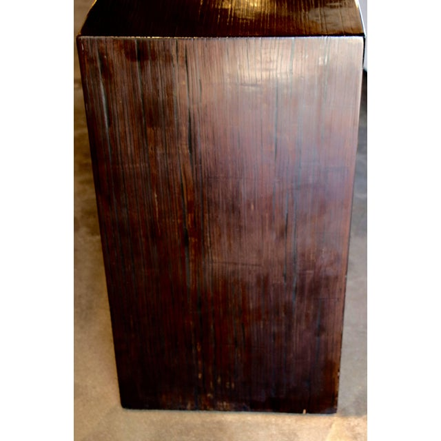 A beautifully grained brown console. I'm not really sure what kind of wood it is, it is possible bamboo veneered and...