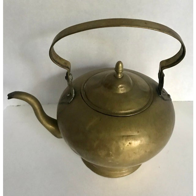 This is a beautiful brass teapot from the late 1800's. It has aged very well, with signs of wear throughout but no major...