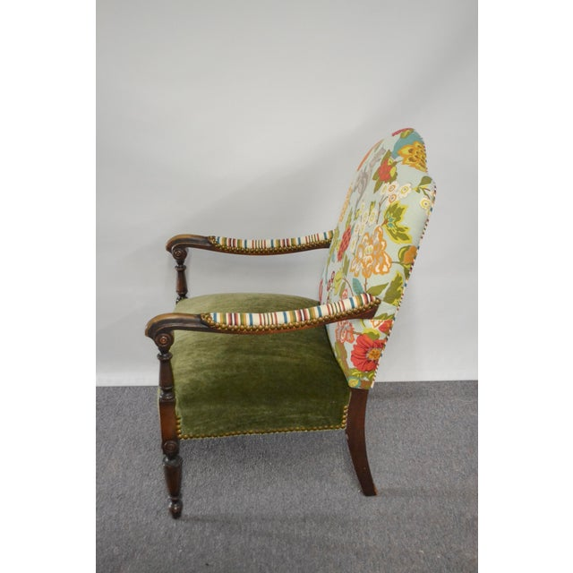 Vintage occasional chair has been reupholstered with all new materials. Inside back has a Fabricut multi colored linen...