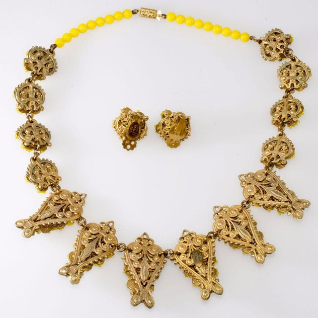 Necklace and earrings set with lemon yellow beads, light yellow seed beads, and small rhinestone accents wired to gold...