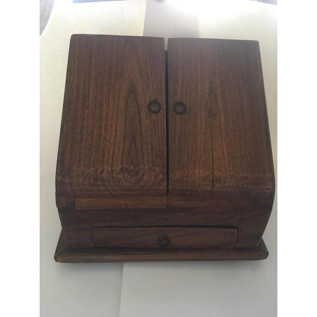 This traditional rustic wooden desk cabinet for a space that needs a little decorative detail; counter, bedroom, closet...