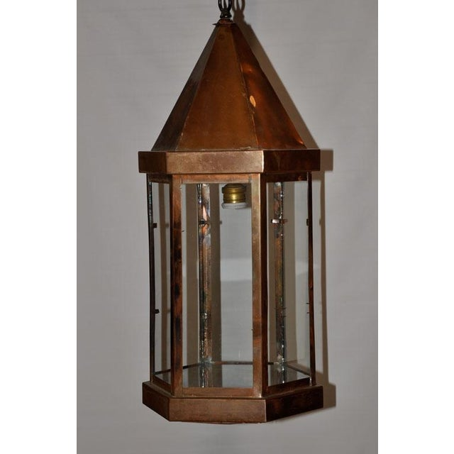 An old English light fitting in copper with clear glass panels. Ideally suited for a hallway, covered entrance or other...