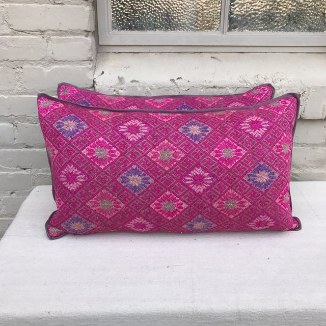 Pair of custom pillows made with hand woven Hmong Tribal Textile with purple linen backs and self cord detail. Down inserts.
