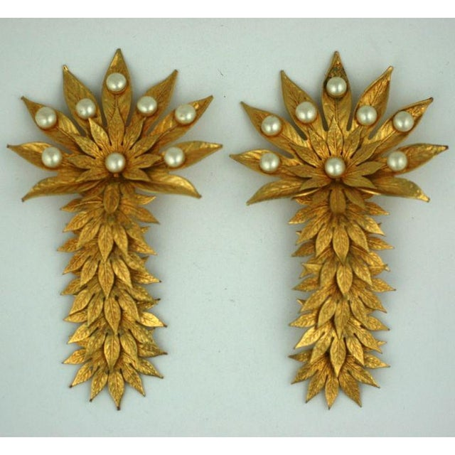 Rare Dominique Aurentis pearl and gilt metal overlapping palm frond massive earclips.Each segment of leaves is articulated...