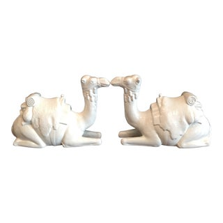 White Ceramic Kneeling Camel Figurines - a Pair