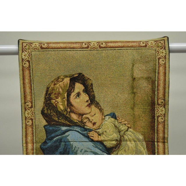 "Item: French wall hanging tapestry featuring ""Madonnia"" by Roberto Ferruzzi. Flush rod strap integrated into the finished..."
