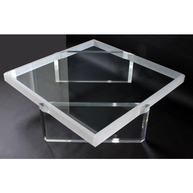 For your consideration is an incredibly lux, large, square coffee table, made of glass and with lucite inserted bases,...