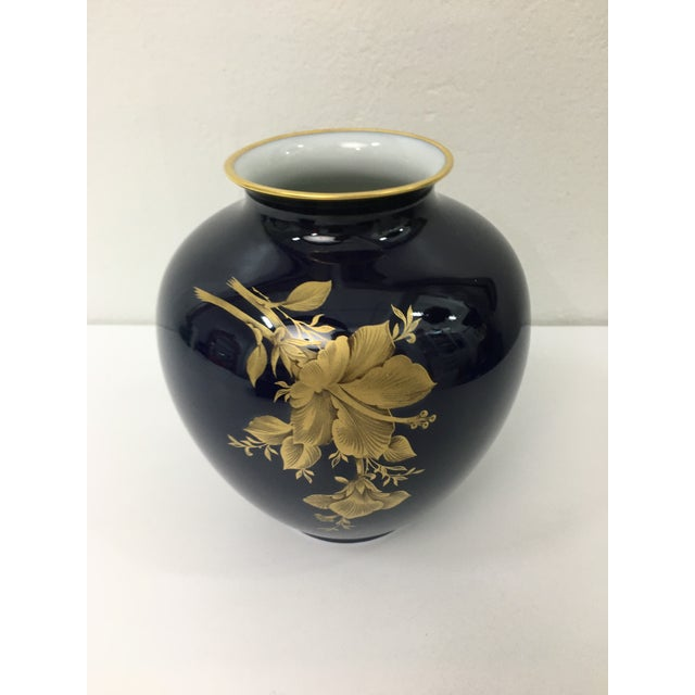 This vase is stunning example of West Germain craftsmanship. Swirling floral motifs in 22 carat gold appear on a rich...
