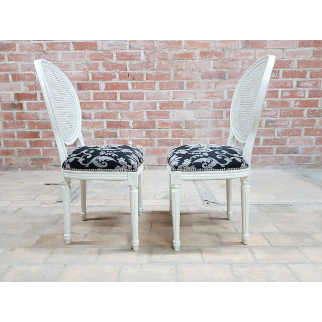 1960s Pair of Vintage French Louis XVI Newly Upholstered Cane Back White Accent Chairs For Sale - Image 5 of 13