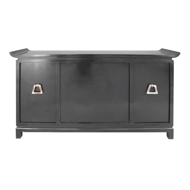 Mid-century modern pagoda style black lacquer bar cabinet with swivel center door and red lacquer interior by James Mont....