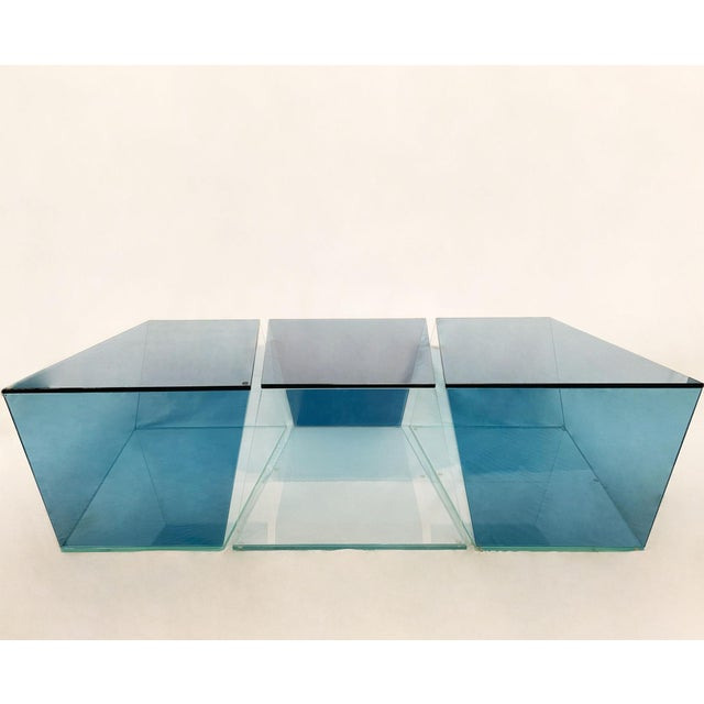 Stunning three piece coffee table composed of blue and clear glass sections. Can be used in multiple configurations. The...