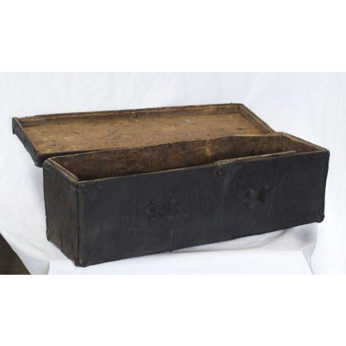 A great rare and early Tibetan wooden trunk covered in leather with forged iron fittings and trim.