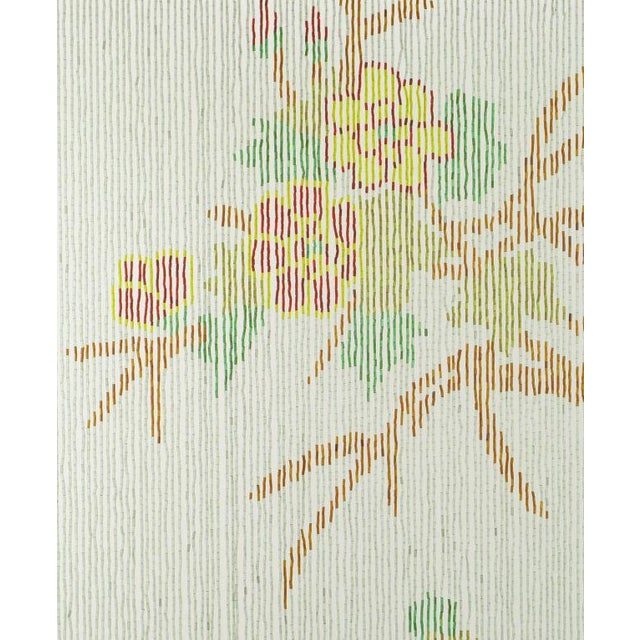 Glass bead window tapestry in blue, green, yellow, black, red and brown depicting a flowering tree branch with a colorful...