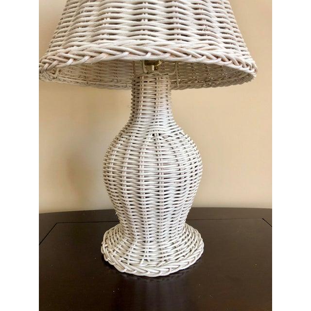 Vintage white wicker table lamp.