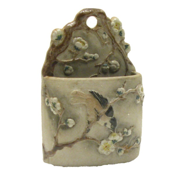 Lovely wall-mounted match keeper with elegant majolica detailing. Matte gray pottery body with glazed accents. Unknown...