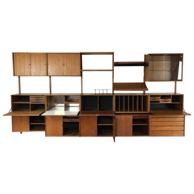 """Poul Cadovius """"System Cado"""" teak floating modular wall shelf system. Danish modern made, purchased and installed in..."""