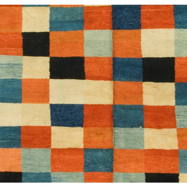 1960's wool Gabbeh rug with blue/rust/multicolor square panels.
