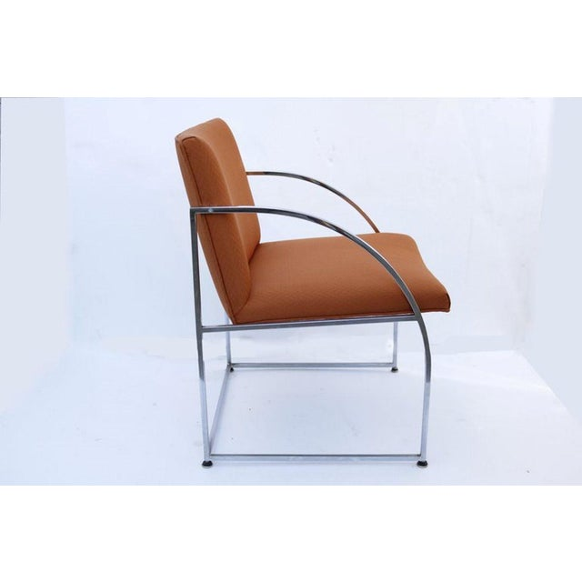 Architectural design chairs by Milo Baughman, framed in chrome and cushioned in summertime-rust/orange fabric.