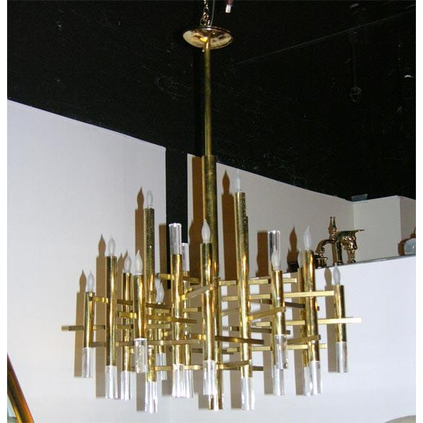 Dramatic Cartesian composition chandelier with eighteen up lights and eighteen cylindrical Lucite accents by Gaetano...