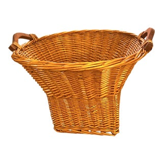 Vintage Late Mid-Century Orange Toned Woven Wicker Basket With Wooden Handles For Sale