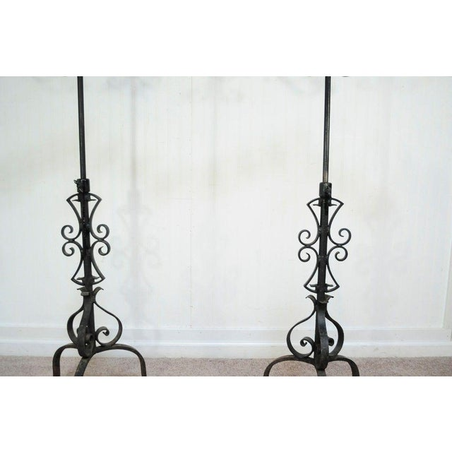 Item: Pair of Tall and Stately Antique Gothic/Mission Revival Adjustable Height Wrought Iron Candelabras Details: 7 candle...