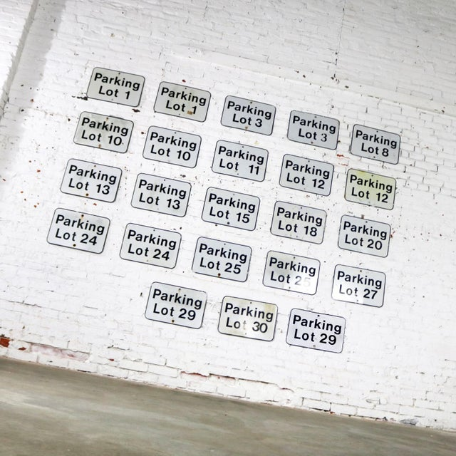 We are offering here twenty-three vintage metal Parking Lot Number signs. They are in differing degrees of condition and...