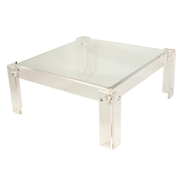 Lucite base and glass top square cocktail table.