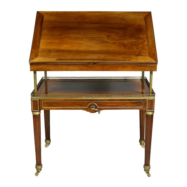 A fine and unusual piece with gilt bronze mounts, when in table position rectangular with a ratcheted adjustable slant lid...