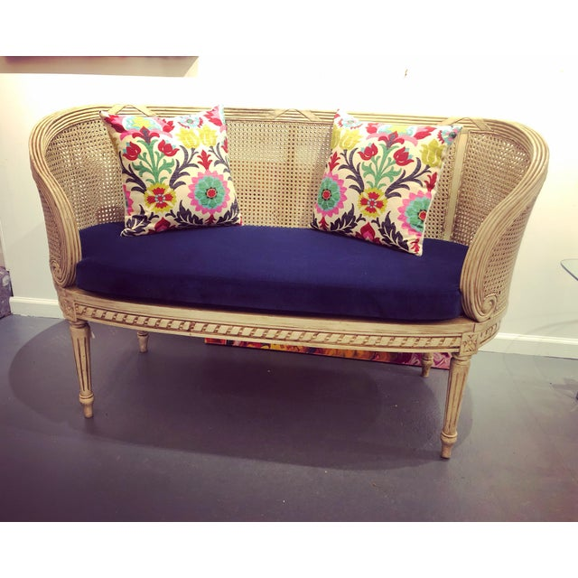 Gorgeous traditional French provincial settee in off white shade and canning on the seat and back with beautiful detail on...
