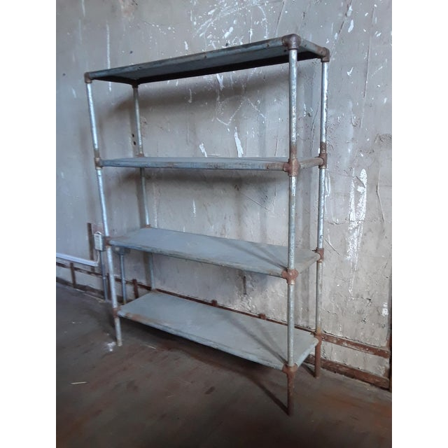 Add an industrial look to any room with this metal storage cabinet with four shelves, allowing plenty of storage for...