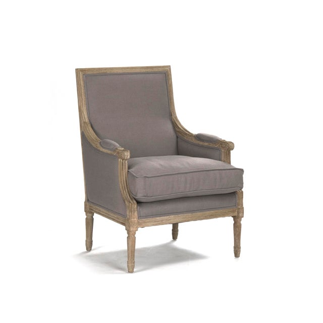 Louis club chair upholstered in grey linen on limed grey oak frame.