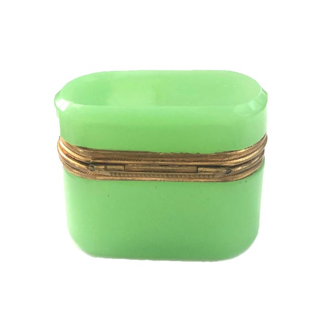 A French lime green opaline crystal box fitted with brass mountings. The box is miniature in form, which is unusual....