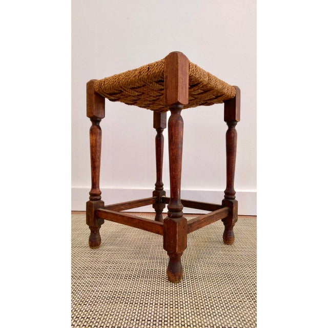 19th-century stool with turned oak frame and woven rope seat. Rope unravelling.