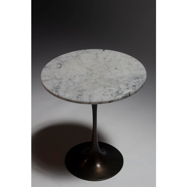 Supremely Elegant bronze and Carrara marble iteration of Eero Saarinen's iconic tulip tables , manufactured by Hugh Acton....