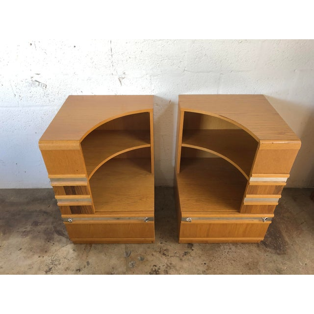 A Pair of Unique Vintage Mid Century Modern Nightstands From the 1980s. Beautiful Blonde Wood Grain with Chrome Handles...