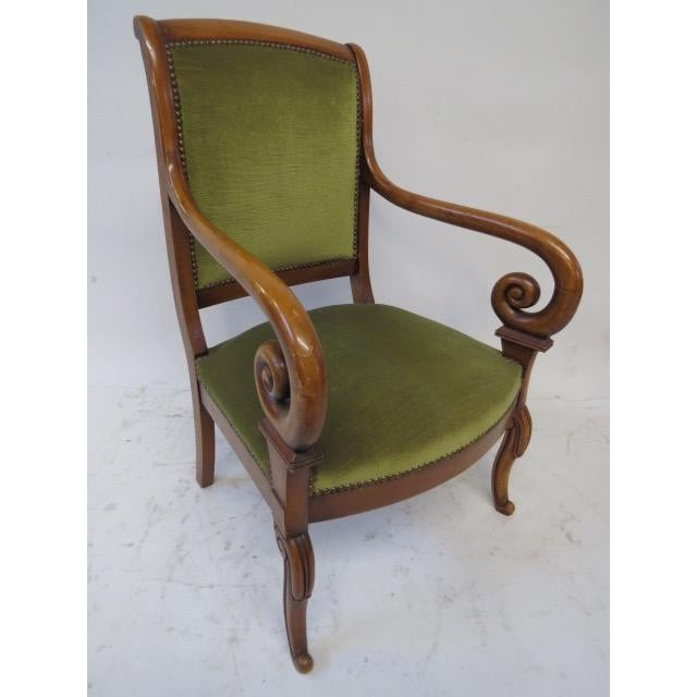Elegant chair from the 1950's. The chair is in the original fabric. Fantastic arms curve down to 4 small tapered legs....