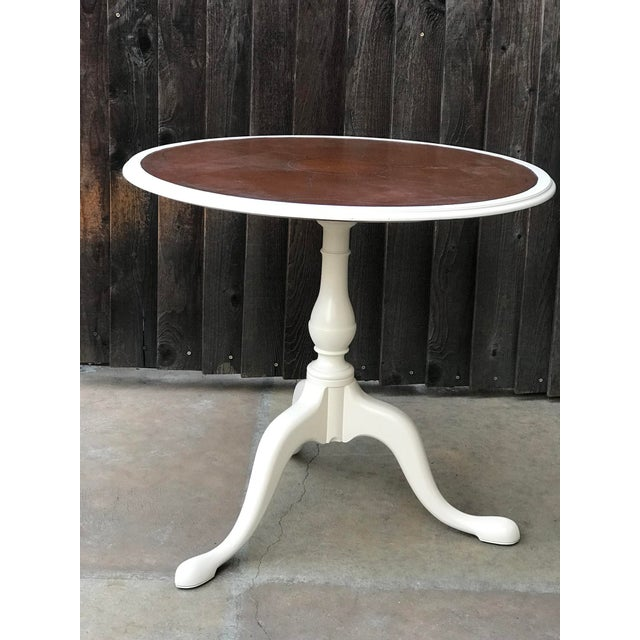 This is a gorgeous pedestal accent table with a leather top with a pedal design engraved into the leather. The legs and...